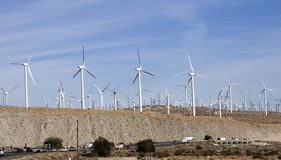 Wind power 3. Windmill farm on top of a hill generating electricty Stock Photo