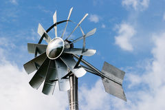 Wind power. A small windmill used to provide aeration in a pond stock image
