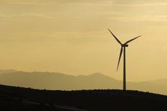 Wind power aerogenerator skyline at dusk Royalty Free Stock Image