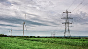 Free Wind Power And Electricity Pylons Stock Image - 56229081