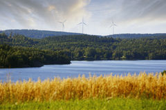 Wind power in beautyful country side. Wind power plant set in a most beautyful rural country-side, inland lakes, trees and mountains. sweden, smaland Stock Photography