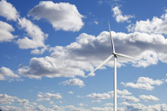 Wind power and clear blue sky with white clouds Royalty Free Stock Image