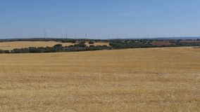 Wind Power in the Desert of Spain. Massive wind turbines generating power. Heat haze effect on desert land. Clean Energy producing of Windmills. Alternative stock video footage