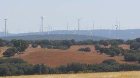 Wind Power in the Desert of Spain. Massive wind turbines generating power. Heat haze effect on desert land. Clean Energy producing of Windmills. Alternative stock footage