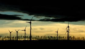 Wind power energy. At sunset Royalty Free Stock Images