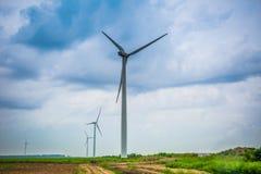 Wind power farm in cloudy Stock Photos