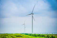 Wind power farm in cloudy Royalty Free Stock Photos
