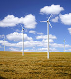 Wind power farm on a field. Wind power farm producing renewable electricity countryside Stock Images