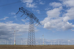 Wind power farm with power line Royalty Free Stock Image