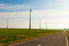 Wind power field with road Royalty Free Stock Images