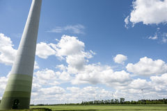 Wind power field on summer day. Renewable energy source wind power on a field in Marchfeld, Lower Austria, Austria Royalty Free Stock Images
