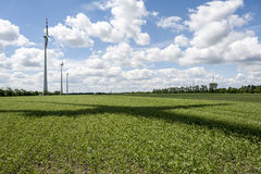 Wind power field on summer day with rotor shadow. Renewable energy source wind power on a field in Marchfeld, Lower Austria, Austria Royalty Free Stock Photos