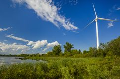 Wind power generating stations in the park Royalty Free Stock Photos