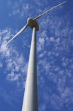 Wind power generator. Over blue skies Royalty Free Stock Photography