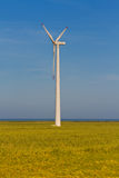 Wind power generator. On wheat field. Alternative green energy Royalty Free Stock Photos