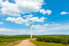 Wind power generator on the grassland Royalty Free Stock Images