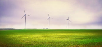 Wind power generator in a green rural landscape artwork. Wind power generator in a green landscape artwork Royalty Free Stock Photos