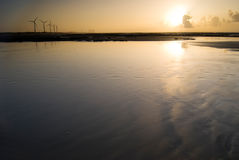 Wind power generator under sunset Royalty Free Stock Photography