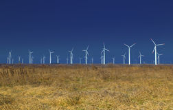 Wind power generators. On blue sky Stock Photo
