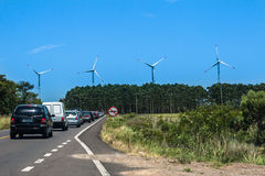 Wind Power Generators Brazil. A route with cars and four Wind Power Generators in the horizon, Osorio, Rio Grande do Sul, Brazil Stock Image