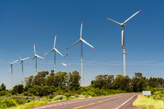 Wind Power Generators Brazil. A route and six Wind Power Generators in the horizon, Osorio, Rio Grande do Sul, Brazil Stock Image