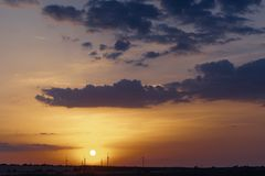 Wind power generators on the horizon against the backdrop of a beautiful sunset. Natural, beach, summer, outdoors, light, sky, evening, night, heaven, travel royalty free stock photography