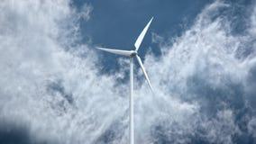 Wind power generators on sky background. Stock Photos