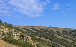 Wind power generators on top of a mountain. Crimea. Royalty Free Stock Photos
