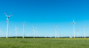 Wind power in Germany. Wind power plant with many windmills seen in Germany stock photos