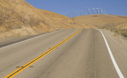 Two Lane Road to Wind Power Hill Royalty Free Stock Image