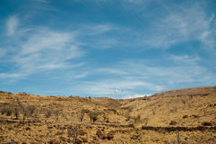Wind power pland on a dry hill on Maui Royalty Free Stock Images