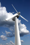 Wind power plant closeup. With motion blur, sky and clouds in the background Stock Illustration