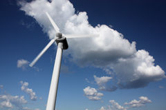 Wind power plant closeup. With motion blur, sky and clouds in the background Stock Photography