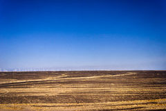 Wind power plant in desert Royalty Free Stock Photo