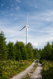 Wind power plant in the forest Royalty Free Stock Image