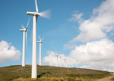 Wind power plant on hilltop Stock Image