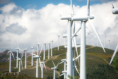 Wind power plant on hilltop Royalty Free Stock Photos