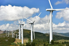 Wind power plant on hilltop Stock Photos
