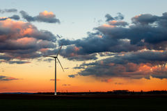 Wind power plant in sunset Stock Image