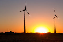 Wind power plant during sunset time. Lithuania Stock Photo