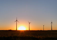 Wind power plant during sunset time Royalty Free Stock Photography