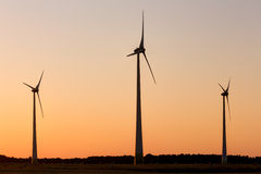 Wind power plant during sunset time Stock Images