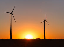 Wind power plant during sunset time Stock Photo