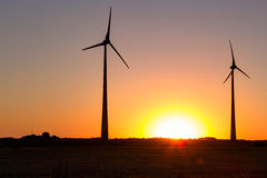 Wind power plant during sunset time Royalty Free Stock Images