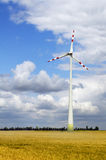 Wind power plant. Wind turbines farm in a bright summer day Stock Photos