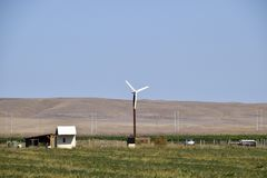 Wind power plant. A wind turbine in the field for generating electricity. Wind power plant. A wind turbine in the field for generating electricity royalty free stock images