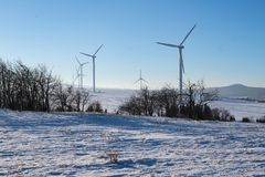 Wind power plants in the winter. Wind power plants in the winter in the Ore Mountains Royalty Free Stock Image