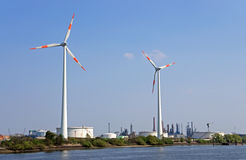 Wind power and refinery Royalty Free Stock Photo