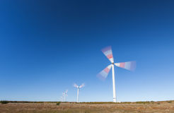 Wind Power Turbines. Spinning Wind Power Turbines Blue sky Royalty Free Stock Photography