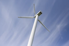 Wind power station against blue sky stock image